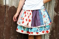 Little girls twirly skirt made out of fabric scraps. Great way to use up leftovers from a big project!