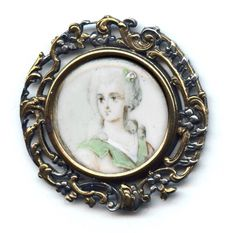 This delicate button includes a portrait on ivory under glass.