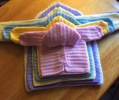 The Crochet Three Way Baby Sweater Pattern is six different sizes from newborn to toddler. I give step by step instructions on making this beautiful garment