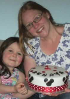 Free Cakes for Kids volunteer Sarah Johnson of Halfway, pictured with daughter Abby and the 50th birthday cake