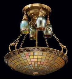 TIFFANY STUDIOS A Leaded Glass and Gilt-Bronze Chandelier, circa 1920 22 in.) diameter, approximately 28 in.) drop each tulip shade engraved L. Bronze Chandelier, Antique Chandelier, Antique Lamps, Antique Lighting, Chandelier Lamp, Vintage Lamps, Chandeliers, Tiffany Chandelier, Vintage Decor