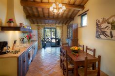 Beautiful country kitchen at Villa Subtilia with french window!
