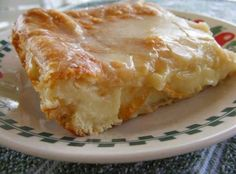 Cheese Danish-2 can(s) refrigerated crescent rolls 2 pkg cream cheese 1 c sugar 1 egg 1 egg white GLAZE 1/2 c powered sugar 2 Tbsp milk 1/2 tsp vanilla extract