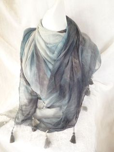 80% Viscose, 20% Cotton. A beautiful blue shades tassel scarf. A very soft and smooth feeling on the skin, a must for anyone's collection.