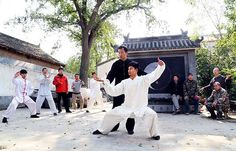 Students practice tai chi at a martial arts school in Chenjiagou, Wenxian county, Henan province, on Nov 1. [Xu Hongxing / for China Daily]