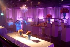 chandelier lighting, LED up lights, table spots and drapery by Design Productions! Wedding and event lighting