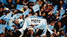 Fans of English Premier League club Manchester City displayed a pro-Ukrainian banner during their final Champions League group game versus Shakhtar Donetsk on Wednesday, but also had their scarves stolen by local ultras.