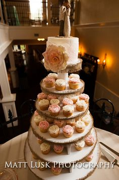 Rustic cupcake tower with soft pinks and creams.  Photo by Matt Lusk Photography www.engagingeventsobx.com  #engagingeventsobx  #outerbankswedding