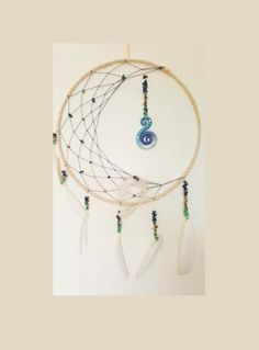 Large half moon  feathered dream catcher with polymer clay spiral by QuiteContraryByElle on Etsy