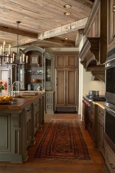 love the colors. Wood ceiling, green cabinets, and cream colored walls.
