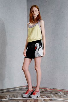 Viktor & Rolf | Resort 2015 | 07 Yellow strappy top and black shorts with swan detail