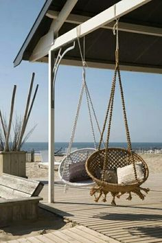 siesta spot - hanging chairs to take in the beach front view