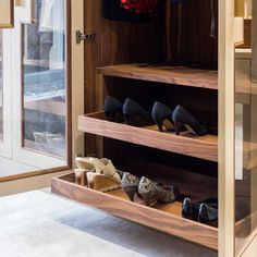 Large dressing room with pull out shoe racks. Created by Bath Bespoke.