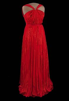 First Lady Michelle Obama's second inaugural gown is now on display as of January 14, 2014.  The ruby-colored chiffon gown designed by Jason Wu is on loan from the White House and will replace the First Lady's first inaugural gown on display for a year. This special loan coincides with the centennial of the original first ladies exhibition at the Smithsonian.