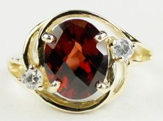 R021, Mozambique Garnet, 10KY Gold Ring * Stone Type - Mozambique Garnet * Approximate Stone Size - 10x8mm  * Approximate Stone Weight - 3.3 cts  * Jewelry Metal - Solid 10k Yellow Gold * Approximate Metal Weight - 3.9 grams  * Ring Size - Size selectable during checkout * Our Warranty - A full year on workmanship  * Our Guarantee - Totally unconditional 30 day guarantee