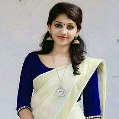 kerala saree with blue blouse Kerala Saree Blouse Designs, Saree Blouse Neck Designs, Saree Blouse Patterns, Onam Saree, Kasavu Saree, Beautiful Saree, Beautiful Indian Actress, Set Saree Kerala, Saree Dress