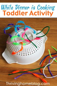 @Kathy Chan Bailey Lower  - fun stuff, with things around the house! toddler activity- shoe laces and a collander