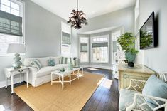 Sherwin Williams Sea Salt for a Beach Style Family Room with a Light Blue Walls and Silver Lake - Sunroom by Echelon Custom Homes