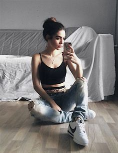 Black crop top with fishnet tights, ripped denim jeans & white Nike shoes by _frankiemiles