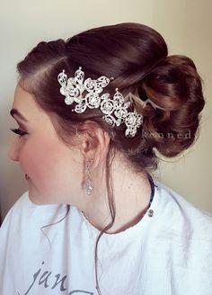 Elegant bridal updo with side braid and diamond embellishment. Hair by Samantha Stiksma of Kailey & Kennedy Cosmetics