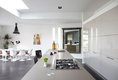 Modern White Coran Kitchen With Walled Cabinets.