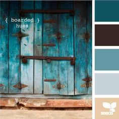 Old, faded turquoise blue door, black iron hardward, inspiration for a color scheme