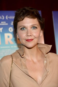 Pin for Later: Celebrities Play With Their Beauty Looks at Comic-Con Maggie Gyllenhaal At the premiere of Very Good Girls, Maggie wore sheer red lipstick and a dash of blue liner in the inner corners of her eyes.