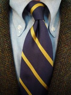 Dark brown herringbone tweed jacket, light blue OCBD, navy tie with yellow stripes