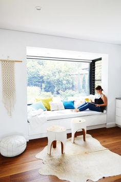 Home tour: Scandi minimalist style in a white and bright home with pops of color. Love this reading nook in he window seat! Photography by Cath Muscat. Styling by Vanessa Colyer Tay. From the February 2017 issue of Inside Out Magazine. Style At Home, Louvre Windows, Bright Homes, Luz Natural, Natural Light, Home Decor Bedroom, Living Spaces, Living Room, Family Room