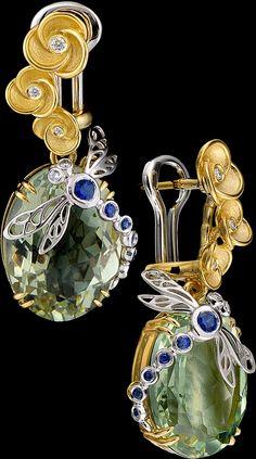 Earrings of 18K yellow and white gold, prazeolit 16,98 ct, diamonds, blue sapphires.
