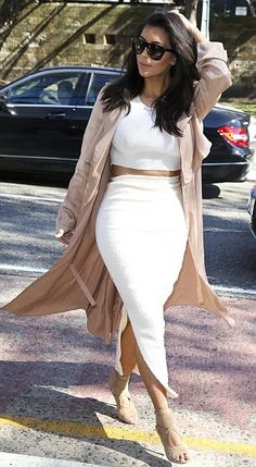Drama! Kim's daring two-piece dress showed the star's bronzed belly thanks to the cropped top and skirt