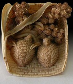 Japanese Ivory Netsuke Two Quails Feeding in Mullet Basket Netsuke Signature: Ittan, early 19th Century