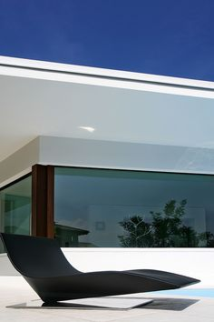 The minimalist House C in Italy by Damilano Studio Architects _
