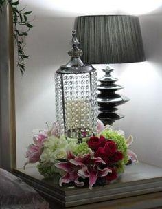 flower arrangements in vase crystal on bedside table