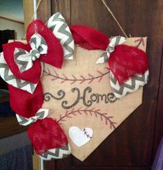 Home is where the heart is at least for baseball families in off season! This spectacular wreath with represent your loveof baseball to all who visit