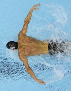 United States' Michael Phelps competes in a men's 200-meter butterfly swimming semifinal at the Aquatics Centre in the Olympic Park during the 2012 Summer Olympics in London, Monday, July 30, 2012. (AP Photo/Mark Duncan)