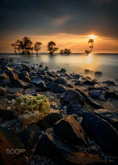 Black Rocks - Sunset at Anyer beach, Banten. Indonesia, by Chandra Chung...