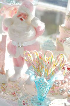 Positively pretty, wonderfully pastel filled vintage holiday table decor. #candy #canes #pastel #pink #retro #vintage #Christmas #table #Santa #cute #kitsch