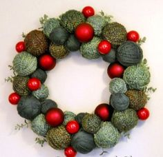 Put together this crafty wreath using styrofoam balls, yarn, and a wire wreath form. By wrapping the yarn around each ball in different directions, make it look like an actual yarn ball. hot glue all of these faux yarn balls onto a wire wreath form, and mix a few red Christmas ornament in as well for some color contrast.