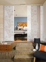 cheap IKEA curtain panels make cute room divider LOVE hte headboard :)