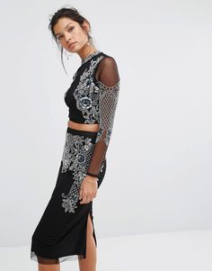 Buy it now. Frock and Frill High Neck Crop Top with Premium Embellishment - Black. Top by Frock and Frill, Woven embellished mesh, High neckline, Button keyhole back, Cropped cut, Regular fit - true to size, Hand wash, 100% Polyester, Our model wears a UK 8/EU 36/US 4. ABOUT FROCK AND FRILL Channelling a vintage vibe with a standout collection of party dresses and glam separates, Frock and Frill mixes catwalk inspiration with Art Deco detailing. With a fresh, feminine approach to fashion…