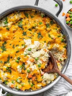 This easy one pot Creamy Chicken and Rice Skillet makes a comforting weeknight dinner during those long, dark winter months! Makes great leftovers, too! BudgetBytes.com
