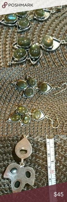 Genuine Natural Labradorite Earrings Beautiful. Each stone has movement of its own! Set in 925 stamped Solid Sterling Silver. Please see all pictures for details. Brand New. Never Worn. Wholesale cost.  All trades and offers will be condidered. Send me your best offer!  Thank you for looking  :) Jewelry Earrings