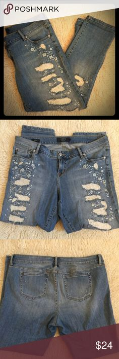 TORRIDs distressed jeans 18 TORRIDs jeans size 18. Distressed with beads and embellishments. Comfortable and stretchy Boyfriend jeans.    Waist: 21.5 43 around. Hip to bottom of jeans: 40 inches. Crotch to bottom: 30 inches. Thanks for looking torrid Pants Straight Leg