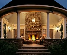 Curved porch with fireplace. It's ok to dream.