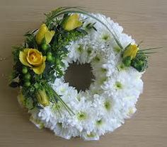 Massed Wreath with yellow top spray