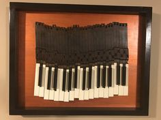 "Piano Keys in frame 24.5"" x 19.5"". Keys from a 1961 piano mounted on painted birch plywood with solid maple painted frame. Maple frame repurposed from piano."