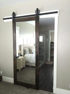 Clever use of a mirror for bedroom barn doors