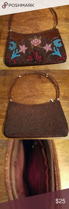 Beaded Purse Great condition. Only flaw are beads on the handle have discoloration but does not take away from the beauty! Clean inside all beads intact on outside. Vintage Bags