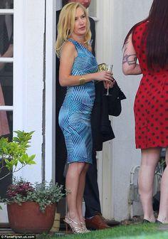 Angela Kinsey attends the wedding reception for Brian Baumgartner & Celeste Ackelson
